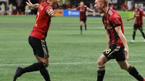 ATL United players celebrating after winning MLS Cup