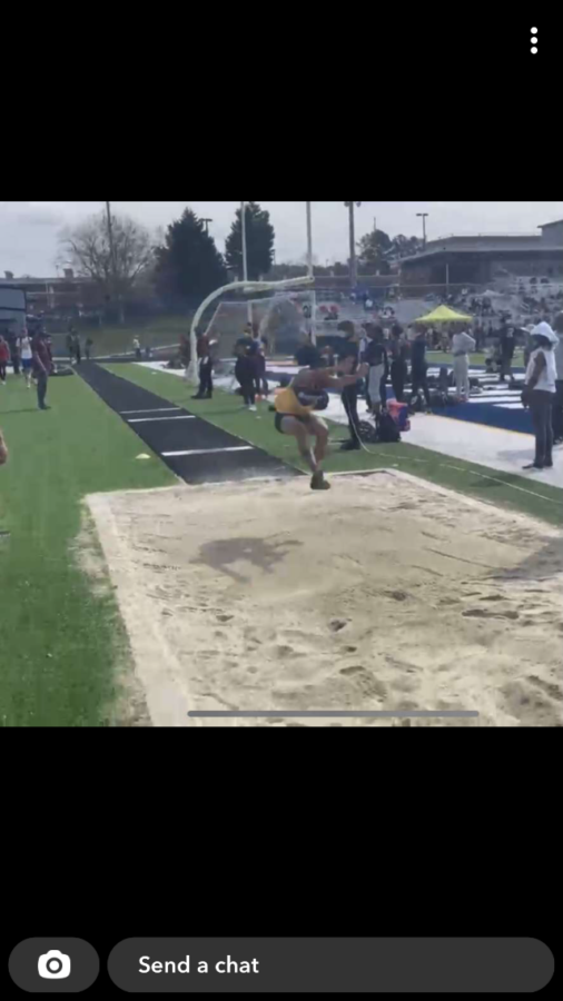 Allyria McBride soars into the air to earn a personal record.