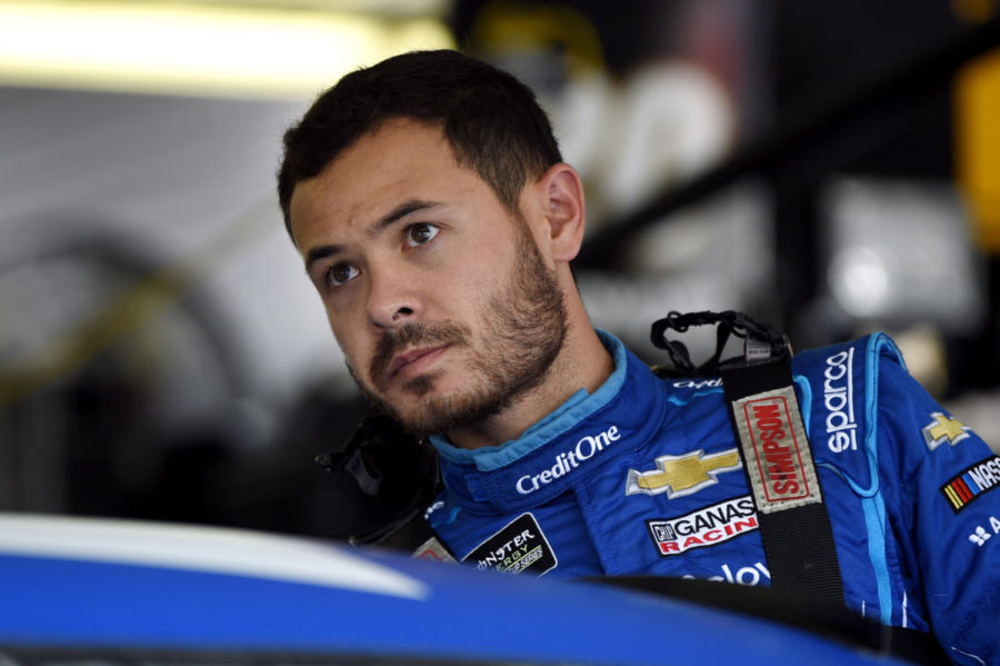 In this July 27, 2019, Kyle Larson climbs into his car for a practice session for the NASCAR Cup Series auto race in Long Pond, Pa. Kyle Larson was fired Tuesday, April 14, 2020, by Chip Ganassi Racing, a day after nearly every one of his sponsors dropped the star driver for using a racial slur during a live stream of a virtual race.