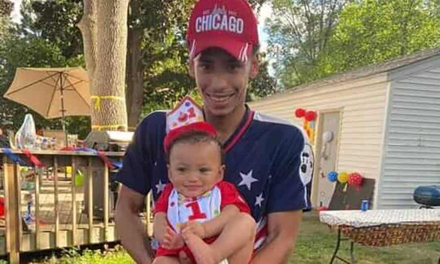 Daunte Wright holds his son, Daunte Jr, at his first birthday party. Wright, 20, was killed during a traffic stop by a white suburban Minneapolis police officer on 11 April.